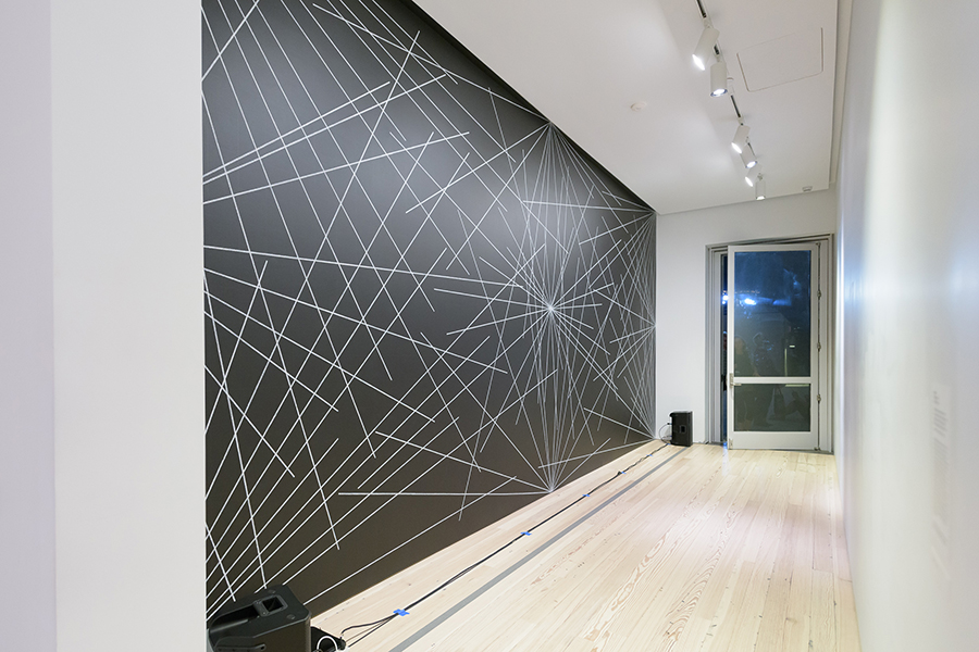 SETH CLUETT ON 4TH WALL: 24 LINES FROM THE CENTER, 12 LINES FROM THE MIDPOINT OF EACH OF THE SIDES, 12 LINES FROM EACH CORNER BY SOL LEWITT